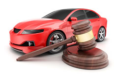 red car and auctioneer gavel